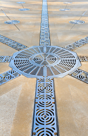 grate: Decorative Steel Grate Covers on Large Patio  Stock Photo