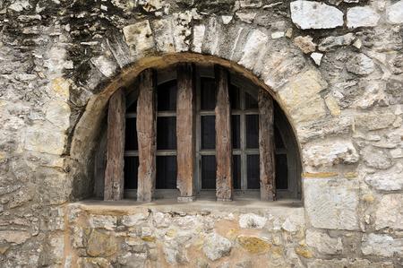 antonio: A Fortified Window in the Historic Alamo Wall in San Antonio, TX