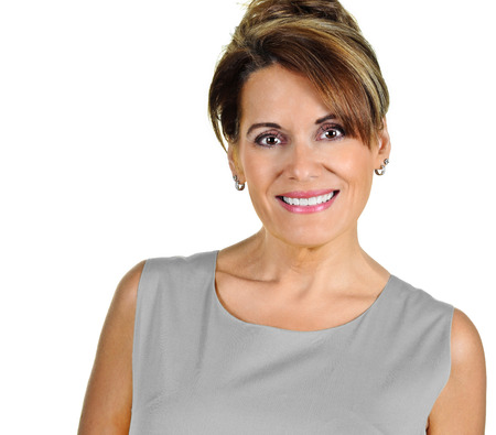 Attractive Mature Woman wearing a Grey Dress Stock Photo