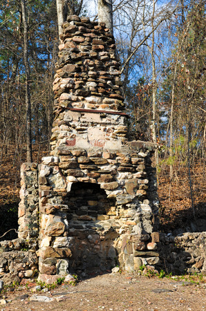masonary: Stone Chimney Still Standing after House Burned Down