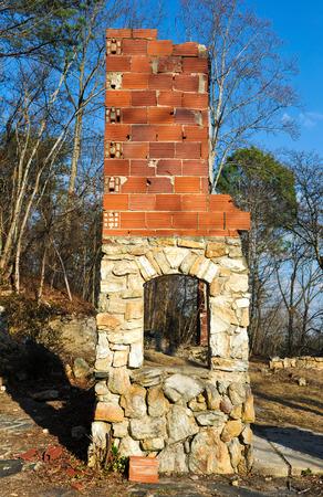 bygone days: Stone Chimney Still Standing after House Burned Down