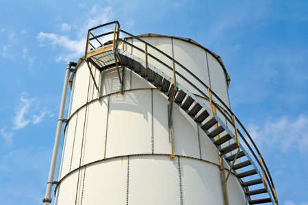 storage: Large Industrial Bulk Storage Tank with Safety Railing