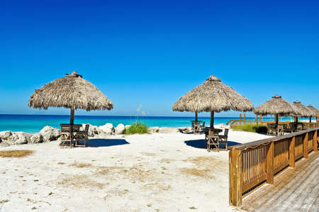 Tiki Huts at an Outdoor Bar on the Beach