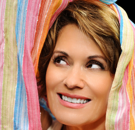 Mature Woman wrapped up in colorful fabric