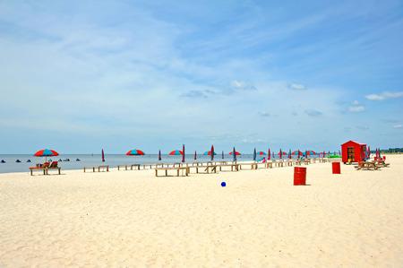 sun bathing: Colorful Beach Umbrella and Sun Bathing Deck on the Beach Stock Photo