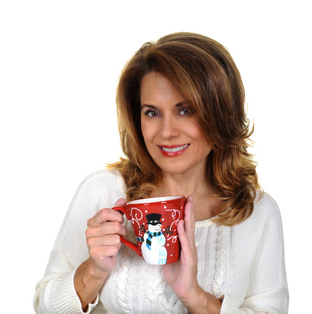 woman sweater: Beautiful Mature Woman in a White Sweater holding a Christmas Cup