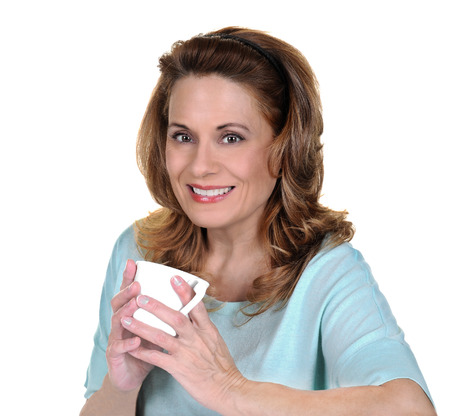 mature brunette: Beautiful Mature Woman in a Sweater holding a White Coffee Cup