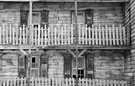 run down: An Abandoned Run Down Farmhouse in Black and White Stock Photo