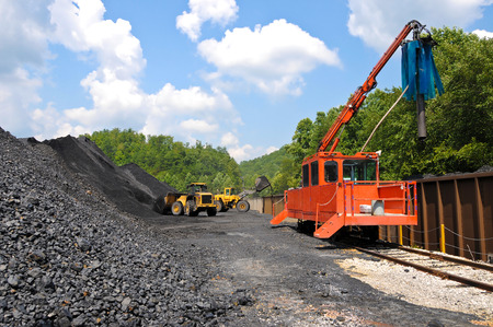 nonrenewable: Large End Loaders loading a Stock Pile of Coal into Rail Cars and taking Samples