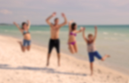 Blur Image of Teenagers Jumping on the Beach during Spring Break for background usage