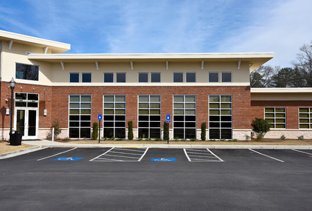 Front Facade of a New Commercial Building with Office Space available for sale or lease Stock Photo