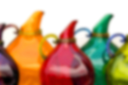 Blur Background Image of Colorful Glass Pitchers isolated on White photo