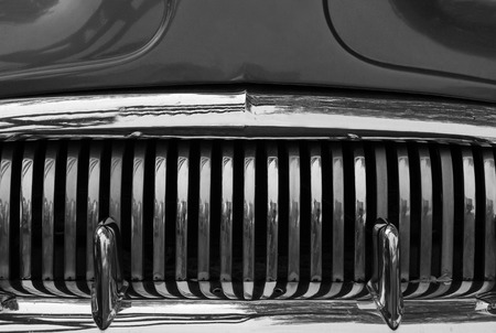 car grill: A close up abstract view of the front grill on an old scrap car