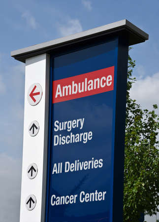 service entrance: Hospital sign showing direction to medical service entrances Stock Photo