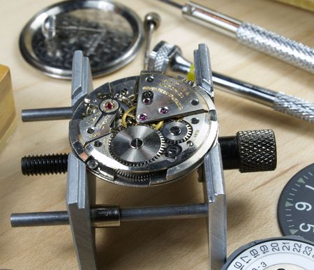 calibre: clock machine and several horology tools Stock Photo