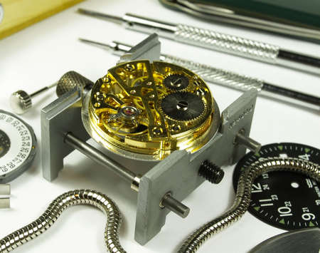 calibre: open clock machine and several horology tools