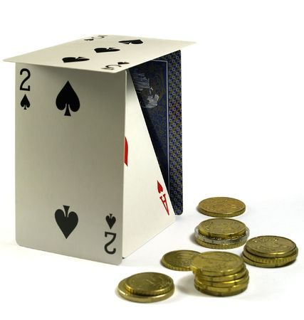 litle: playing cards doing a litle house   and several euro coins Editorial