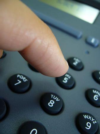 caller: telephone keys and finger Stock Photo