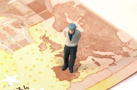 future earnings: old person figure over a banknote