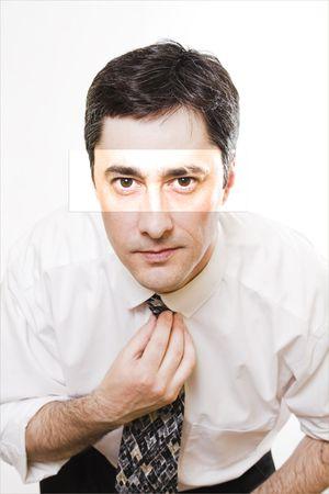man adjusting tie in mirror photo