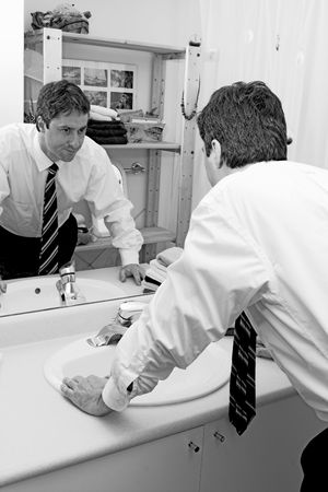 stressed man looking in mirror Stock Photo - 408679