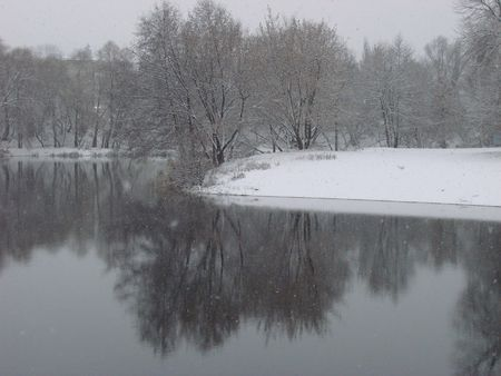 First season�s snowfall on Ukrainian River Psyol in Sumy photo