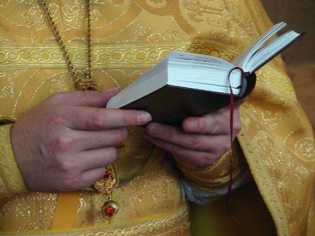 slavic: Slavic Gospel in hands of russian orthodox priest Stock Photo