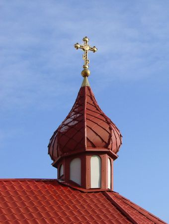 aloneness: Orthodox Churchs Cupola with Holy Cross upon blue sky