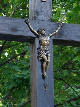 minster: Ancient crucifixion cross with metal Jesus figure