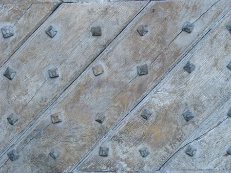 Aged nailed wooden door photo