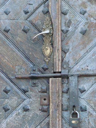 Aged door lock on wooden door photo