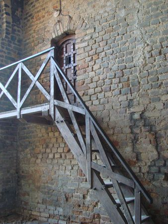 Ancient castle tower wall with ladder photo
