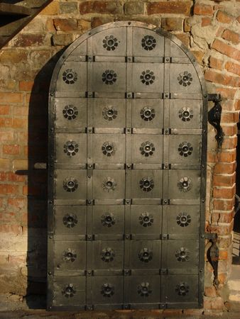 Aged nailed metal door of castle photo