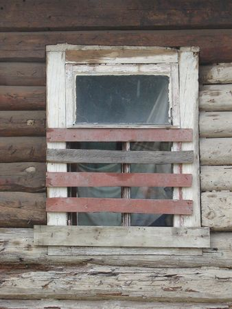 aloneness: Alone aged ruined urban window