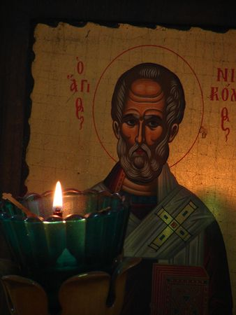 Slavic St Nicolay Icon and burning candle