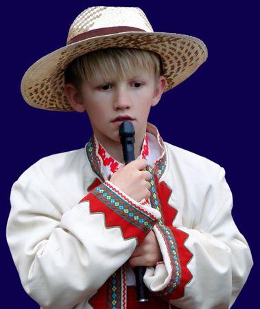 aloneness:    Boy folk musician with Ukrainian instrument sopilka