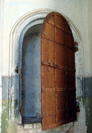 Ancient metal doorway of monastery photo