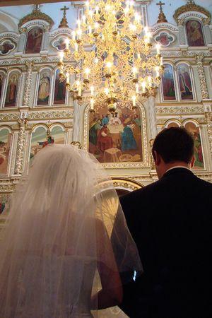 Wedding Couple inside old Orthodox Cathedral photo