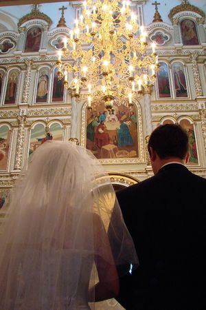 to implore: Wedding Couple inside old Orthodox Cathedral
