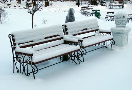 Snowy winter town square benches photo