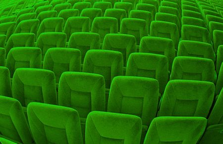 truthful: Group of many green seats in public hall