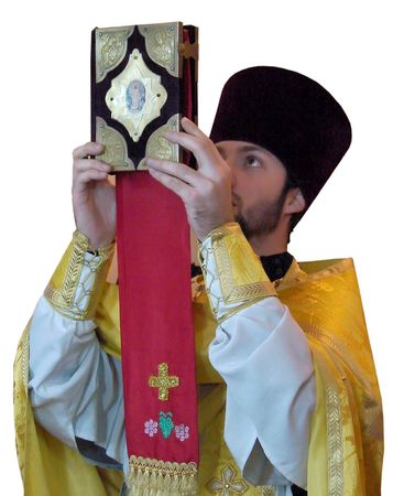 A Ukranian Orthodox priest rising ancient Holy gospel photo