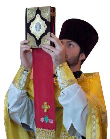 A Ukranian Orthodox priest rising ancient Holy gospel photo