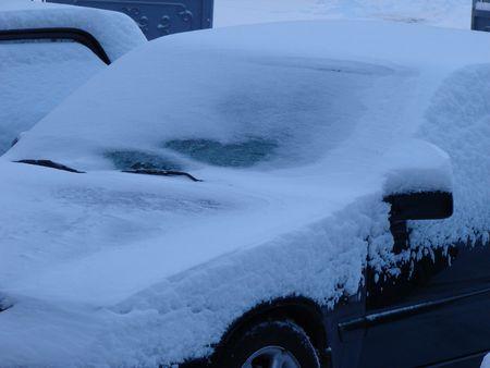 Snowed cars after night snowfall photo