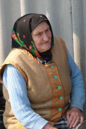 aloneness: Old Ukrainian country sad granny portrait Stock Photo