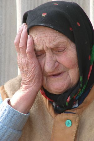 ruination: Old Ukrainian country sad granny portrait Stock Photo
