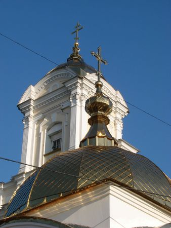 Orthodox Churchs Cupola with Holy Cross upon blue sky photo