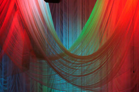 Scene background curtains illuminated with color lights photo