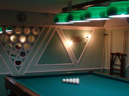 Pool table with white balls on green table photo