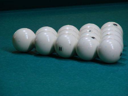 White balls on green textile pool table photo